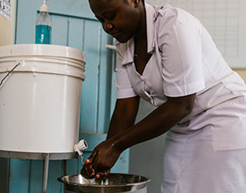 Jackeline Gideon Mwiguta, a nurse/midwife at the Nyarugusu Dispensary in the Geita Region of Tanzania